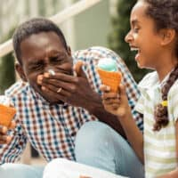 Summer Activities for Families - dad and daughter eating ice cream and laughing