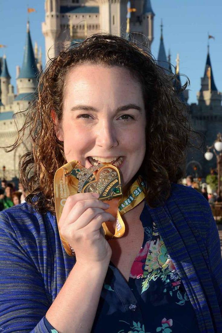 runDisney Princess Half-Marathon Medal in front of the Castle