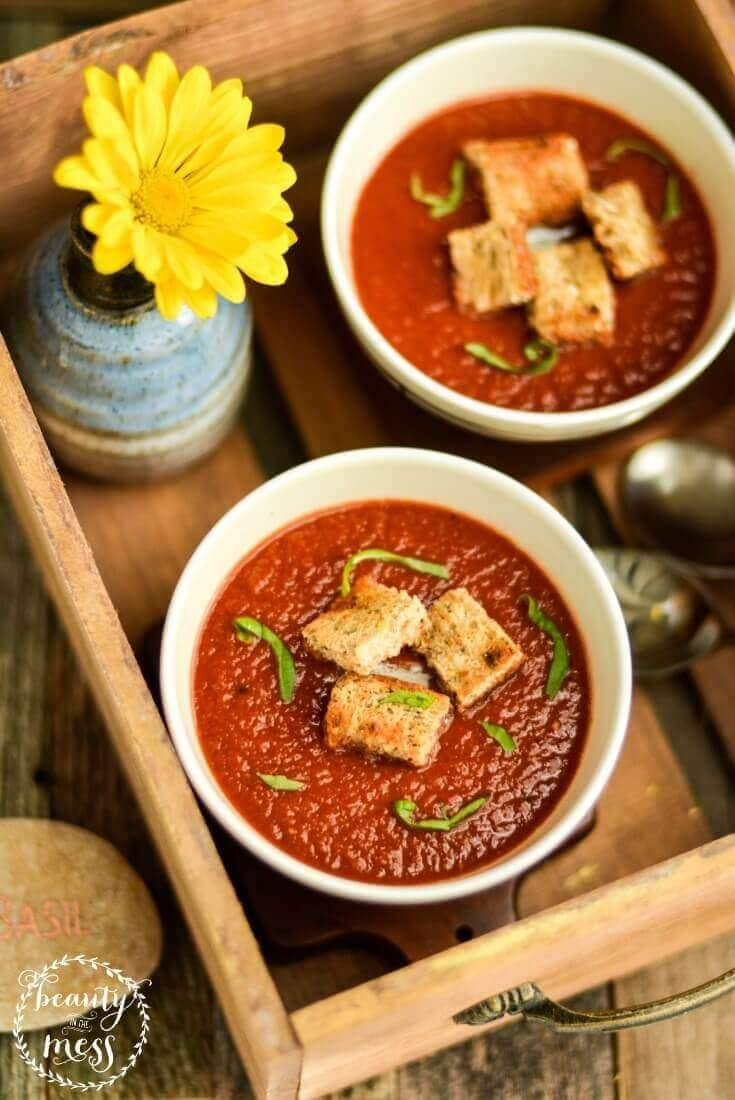 The best tomato soup you have ever tasted! Easy Tomato Basil Soup will redeem cold days. It's that good.