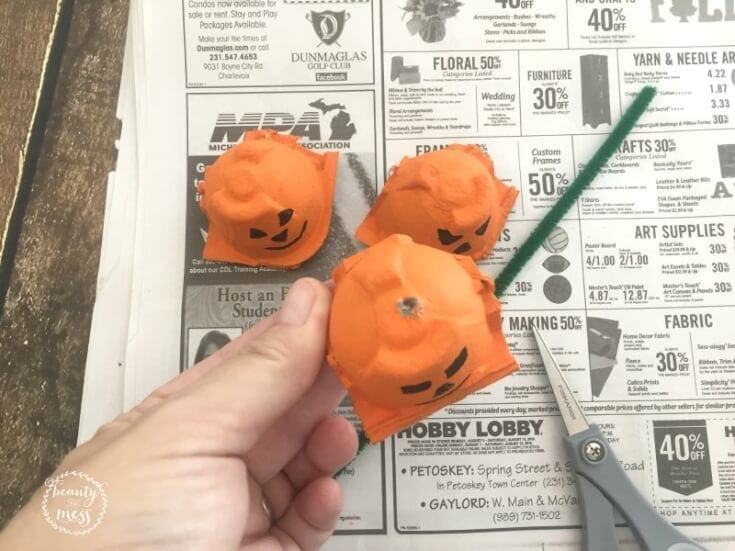 -When the pumpkins are dry, use the craft scissors to gently poke a hole in the top of each pumpkin