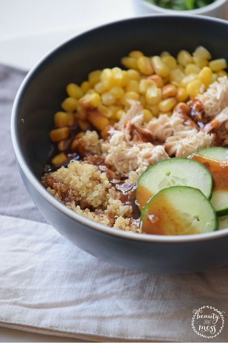 Every part of this chicken quinoa bowl is delicious with perfectly seasoned quinoa, fresh cucumber, sweet corn, tender chicken and a drizzle of tamari sauce. Perfect for busy nights and freezer meals. via @simplifyingfamily
