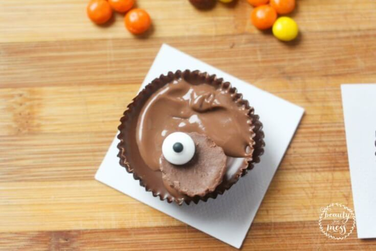 attach-the-candy-eyes-to-the-top-half-of-the-reeses-mini-using-a-touch-of-melted-chocolate