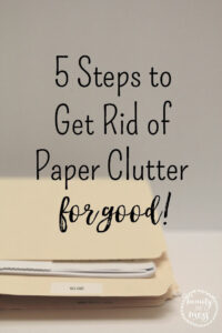Folder holding paper. 5 Steps to get rid of paper clutter for good.