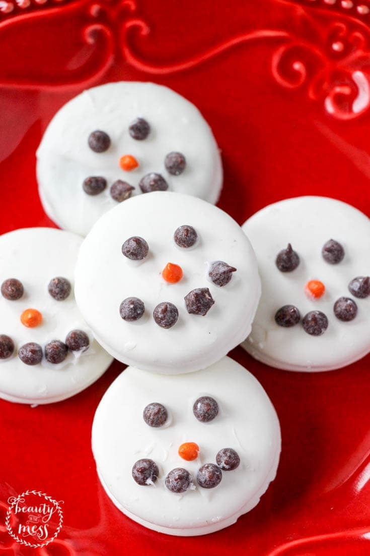 Make these adorable white chocolate covered OREO Snowman Cookies as a fun snack or classroom treat. Would make perfect neighbor gifts too.