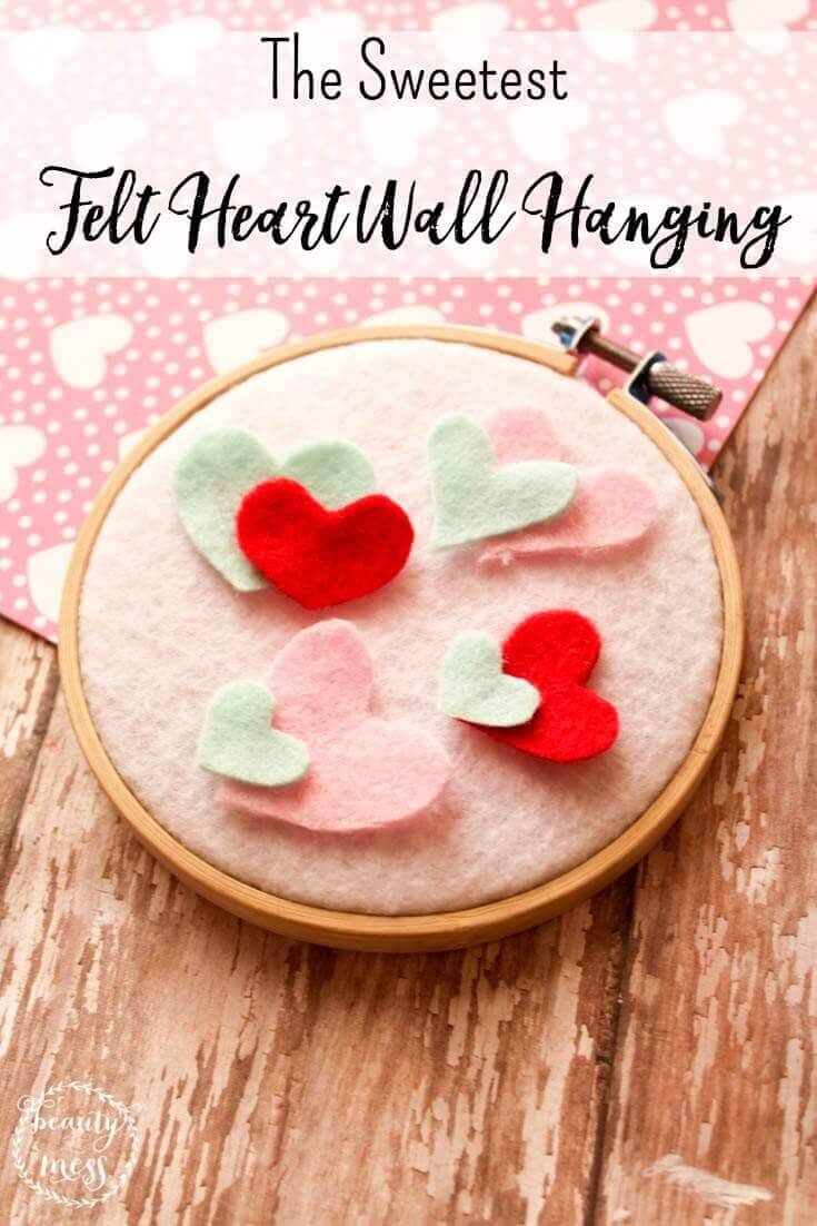 Perfect for your Gallery Wall, Valentine's Day decor, or for decorating your little girl's room. This DIY felt heart wall hanging is easy. via @simplifyingfamily