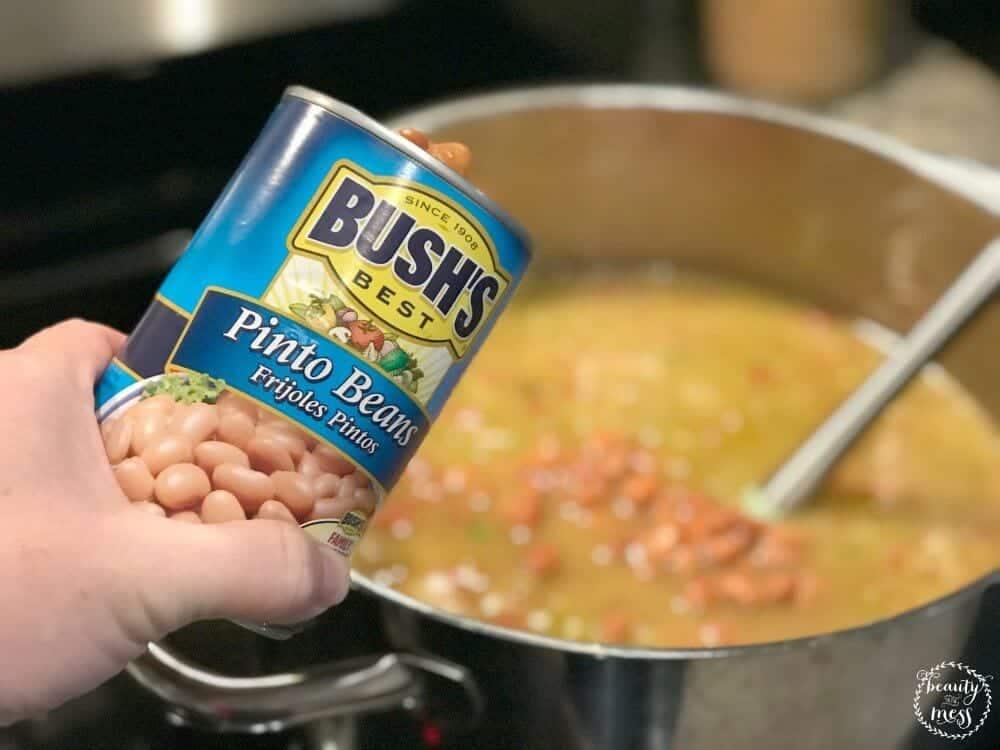 CO Pork Green Chili adding Bush's Best Pinto Beans
