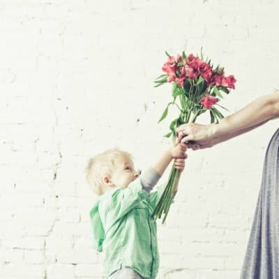 Son Giving Mom Flowers