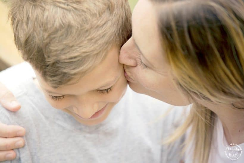 Mom kissing son on cheek