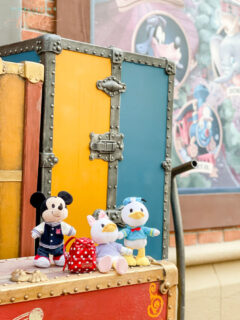 Disney's Mickey Mouse, Donald Duck, and Daisy Duck Disney nuiMOs at Magic Kingdom on trunk with backpack
