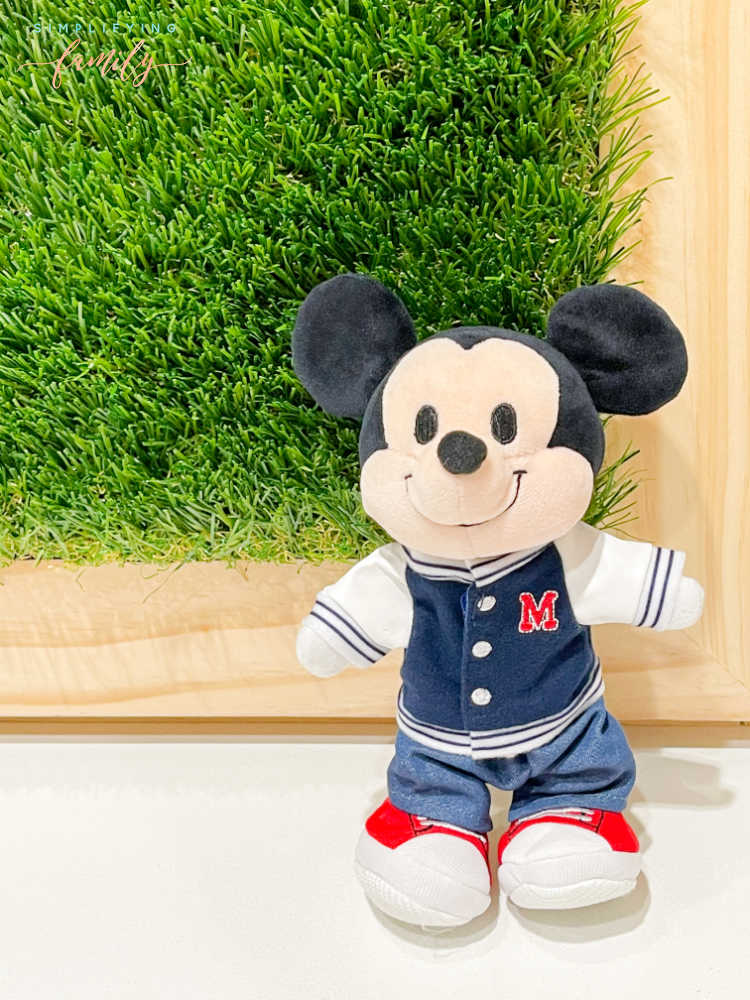 Mickey Mouse Disney nuiMOs standing in front of grass wall with natural wood frame