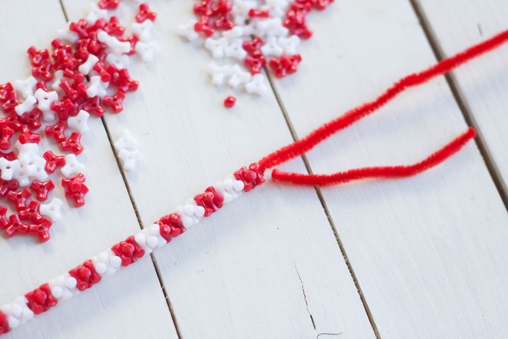 Adding beads to pipe cleaner