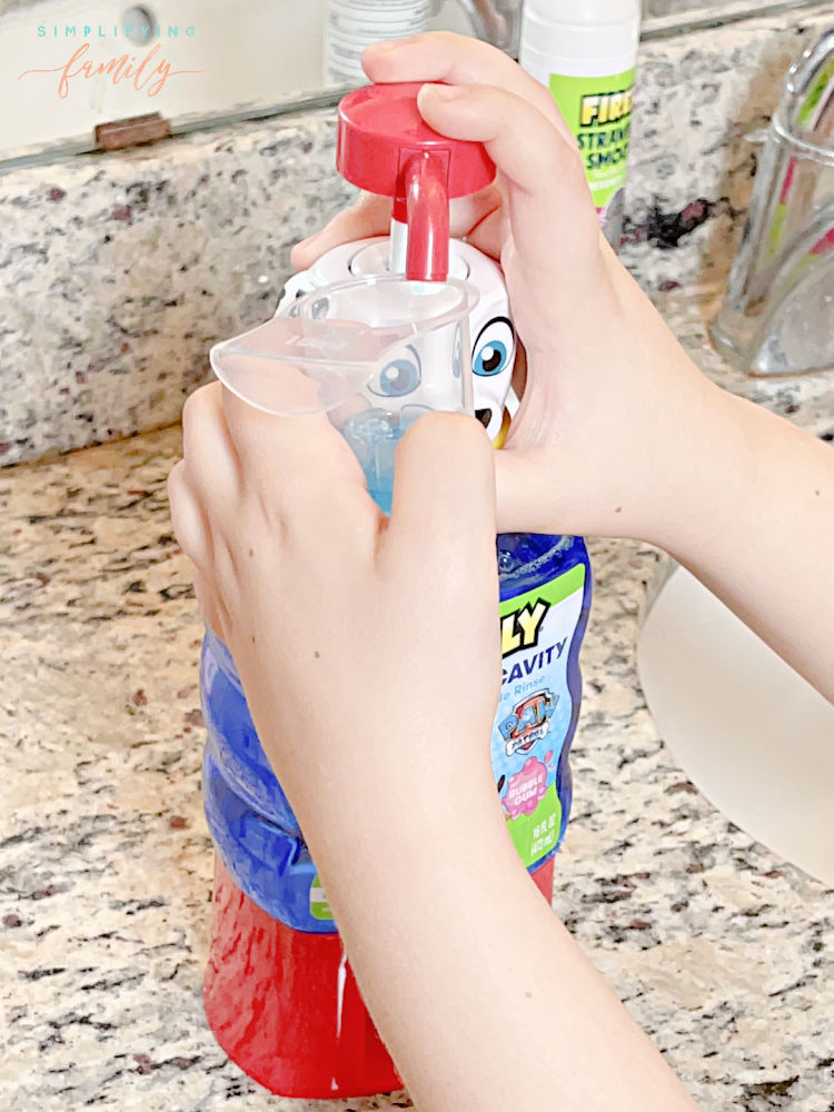 Brushing Teeth with Firefly Mouthwash