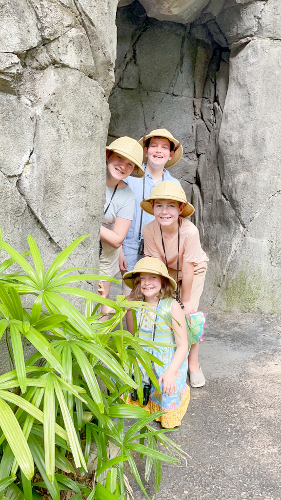 Four children in safari hats going to visit Gorilla Falls Exploration Trail, Presented by OFF!®Repellents at Disney's Animal Kingdom